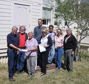 Jim Moorhead handing a check for $5,000 for a dishwasher for the Community Center, a grant awarded to Caspar Community by the Community Foundation of Mendocino County.