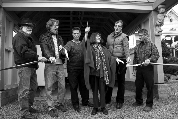 Ribbon cutting at the Dedication of the Caspar Mail Pavilion. From left: David Alden, head carpenter; Paul Reiber, sculptor; John Wozniak, foreman; Susan Juhl, ribbon cutter; Daniel Dickson, architect; and Paul Schulman, Caspar Board President.
